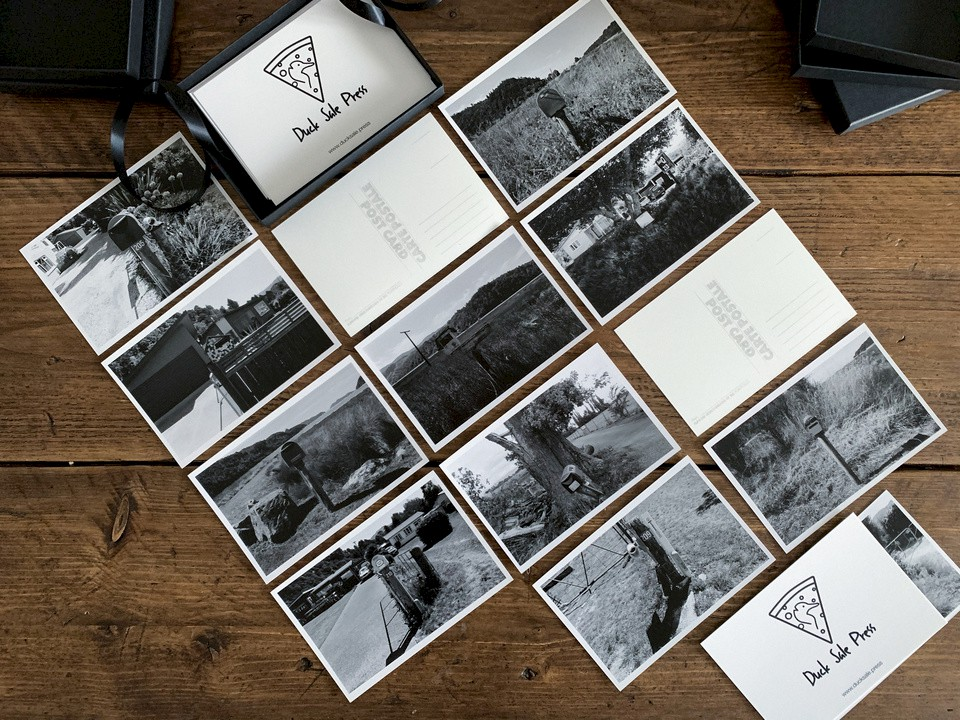 Full set includes 13 hand printed silver gelatin postcards in a presentation box